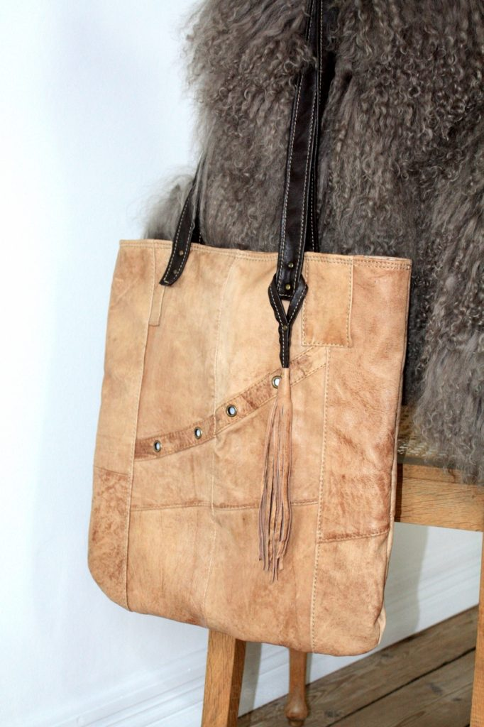 Brown, soft like a butter, acid-washed lamb leather city bag