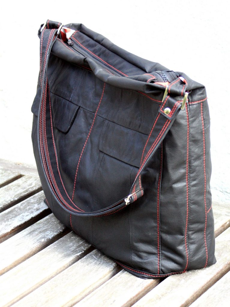 Black bag with red and white linning.