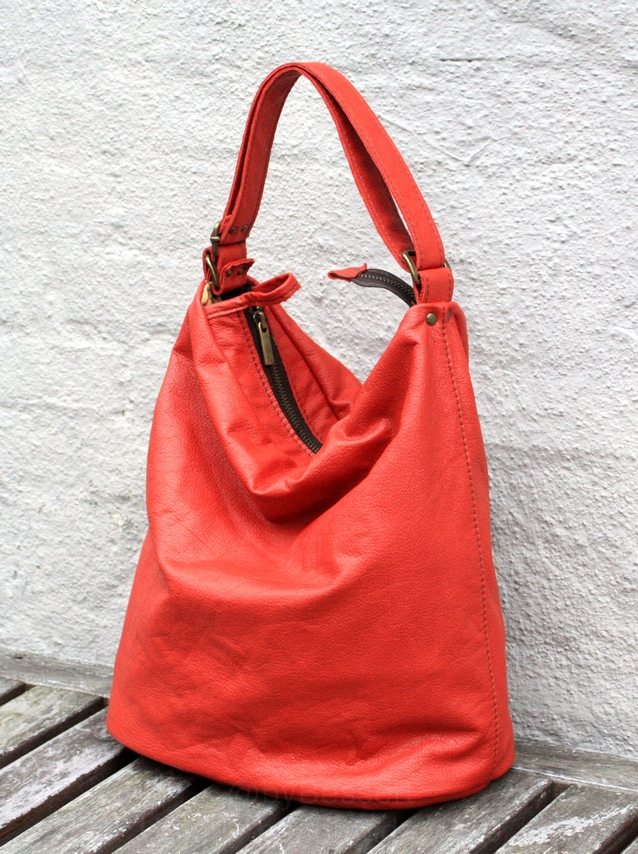 A rusty-orange leather bag